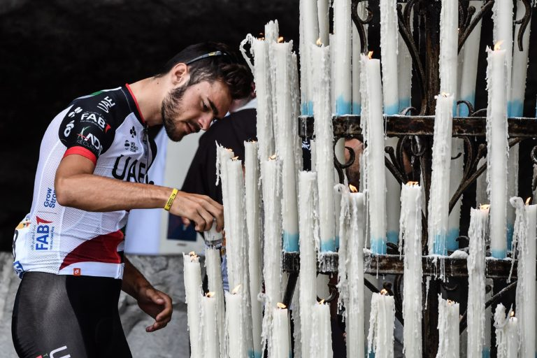 Italy's Oliviero Troia lights a candle during a ceremony at the shrine of Lourdes (Getty Images)