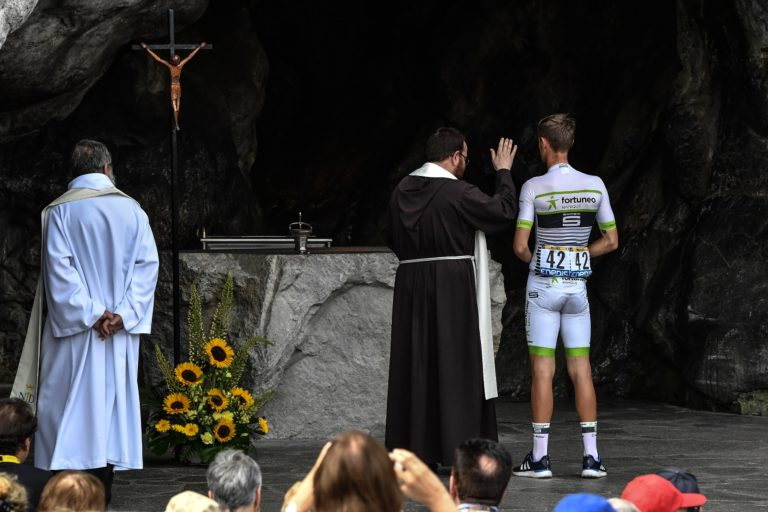 A priest blesses France's Maxime Bouet (Getty Images)